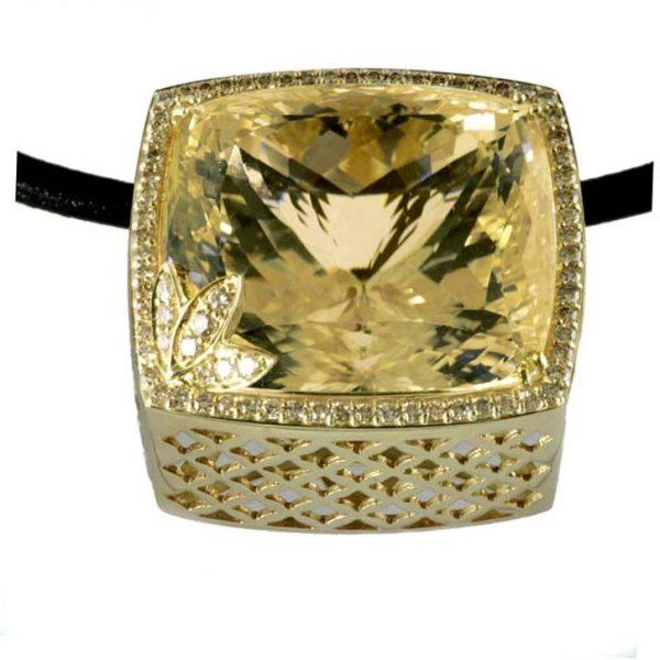 157.00 ct. yellow kunzite, diamond & 18K gold pendant
